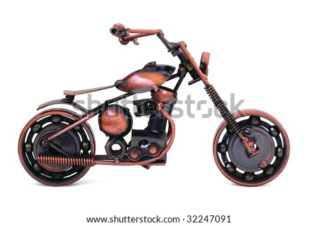 Handmade model of custom motorcycle. Bronze scale model of chopper. Side view. Isolated on white - stock photo