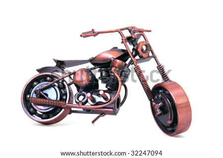 Handmade model of custom motorcycle. Copper scale model of chopper. Side view. Isolated on white - stock photo