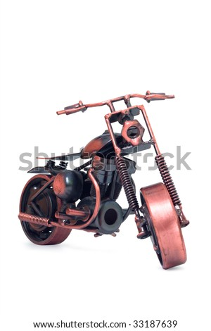 Handmade model of motorcycle. Front view. Isolated on white - stock photo