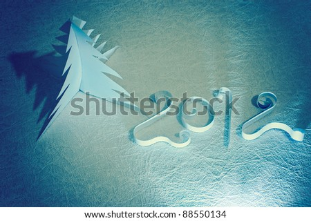 Handmade New year symbols made from paper: 2012 and Christmas tree. Retro. - stock photo