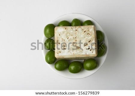 Handmade olive soap with green fresh olives.