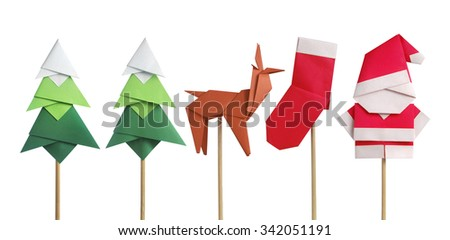Handmade origami paper craft Santa Claus, green Christmas trees, reindeer and stocking isolated on white - stock photo