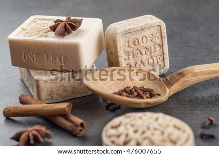 handmade ornamental soaps with cinnamons and anise on black background, product of cosmetics and body care