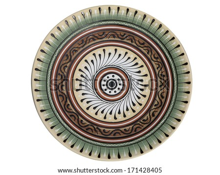 handmade ornated pottery plate isolated on white background - stock photo