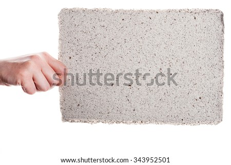 Handmade paper in woman hand isolated on white background    - stock photo