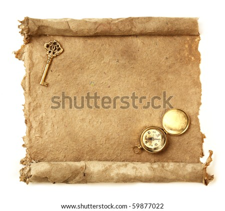 Handmade paper scroll with key and a compass