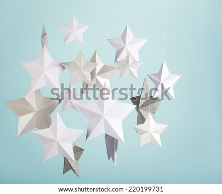 Handmade paper star decorations. - stock photo