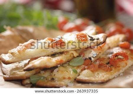 handmade pizza  with cherry tomato and herbs - stock photo