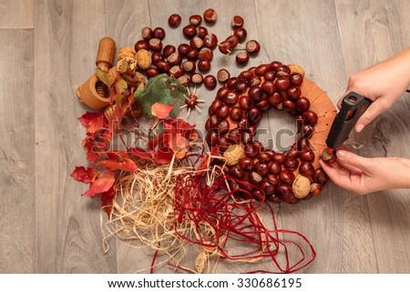 Handmade production of Christmas wreaths using weld gun (Shallow DOF). - stock photo