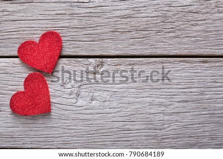 Handmade red hearts on left on rustic wood. Happy lovers day card mockup, copy space. Valentine's day holiday concept
