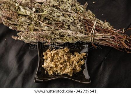 Handmade scrub with lavender in black ceramic bowl - stock photo