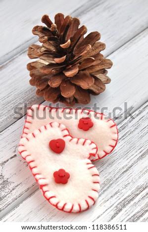 Handmade small mittens Christmas decoration - stock photo