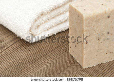 handmade soap and towel on wooden