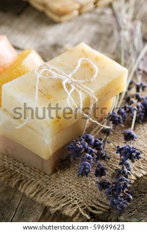 Handmade Soap closeup and Lavender flowers - stock photo
