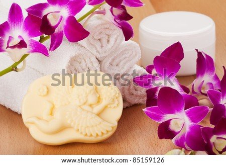 Handmade soap with natural ingredients, white towels, spa cosmetic and orchid - stock photo