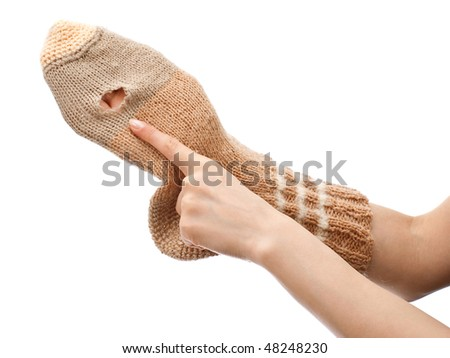 Handmade sock with hole isolated on white background