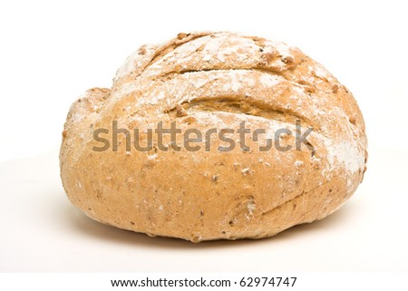 Handmade Spelt n Rye Bread from low perspective isolated on white. - stock photo