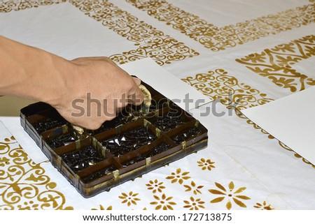 Handmade stamping batik pattern on white cloth  - stock photo