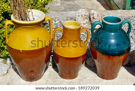 handmade terracotta containers for oil, wine, etc - stock photo