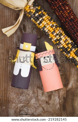 Handmade Thanksgiving decorations - Pilgrim and Indian. - stock photo
