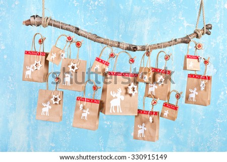 Handmade tinkered advent calendar with paper bags, natural material