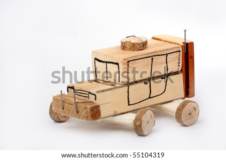 Handmade toy car from wooden blocks on white background - stock photo