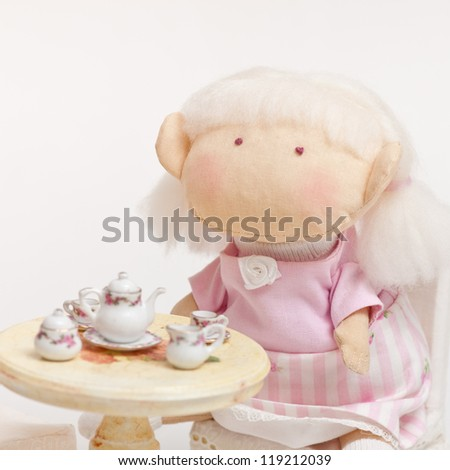 handmade toy cute litlle girl having a tea - stock photo