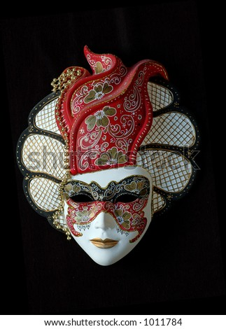handmade Venetian mask (red) The colours of the masks are typical of 18th century theatre in Italy. - stock photo