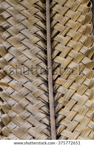 Handmade weave tracery from coconut dry leaves . - stock photo