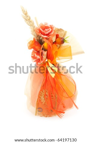 Handmade wedding favor isolated on white background.
