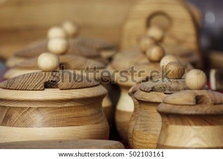 Handmade wood dishes with caps at market