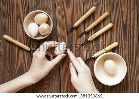 handmade,wood eggs,  work with wood, tools for working with wood, a chisel, a brown wooden background of boards, rustic, - stock photo
