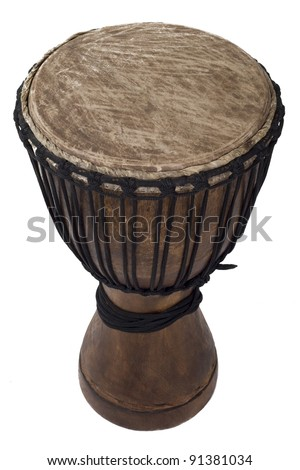 handmade wooden drum with goat skin, ethnic musical instrument of carved wood and leather membrane, isolated with clipping path - stock photo