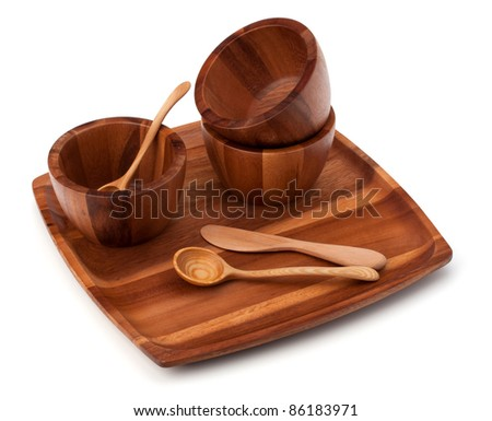Handmade wooden kitchen dishes isolated on white background - stock photo