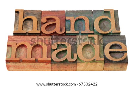 handmade word in vintage wooden letterpress printing blocks, stained by color inks, isolated on white