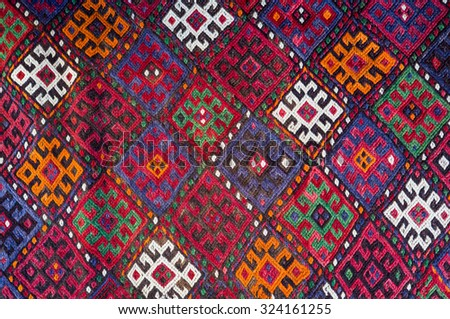 Handmade woven rug and tapestry - vintage carpets on a Turkish bazaar. Traditional Turkey rugs - oriental craft and decor of interior. - stock photo