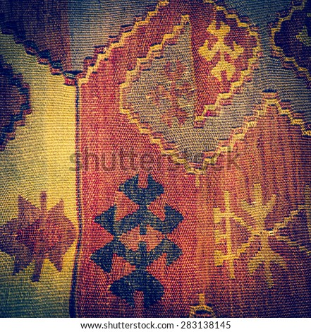 Handmade woven tapestry - vintage carpet on a Turkish ornament. Traditional Turkey rug - oriental craft and decor of ethnic interior. - stock photo