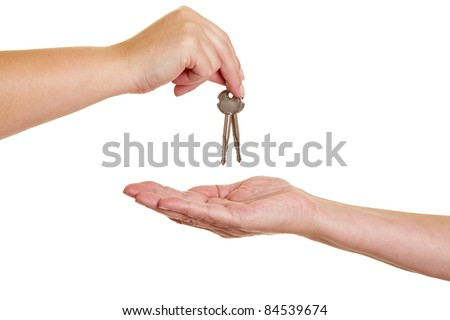 Handover of keys from one hand to another - stock photo