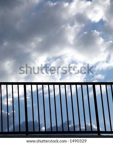 Handrail with cloudy sky