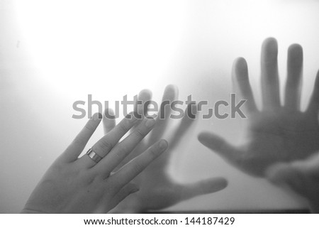 Hands against the glass