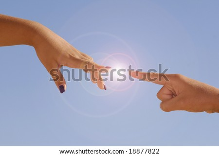 Hands almost touching against a blue sky