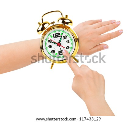 Hands and alarm clock like a watch isolated on white background - stock photo