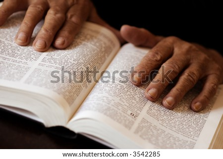 hands and bible (special toned photo f/x, focus point on fingers (left hand selective))
