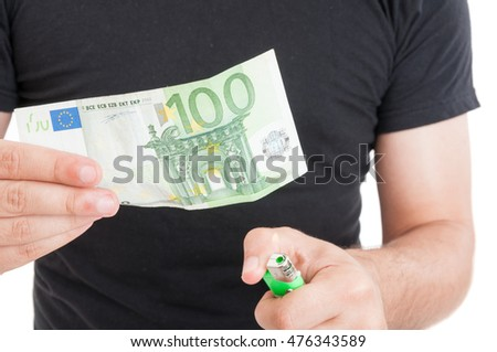 Hands and burning money in closeup on white background