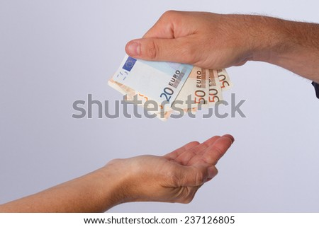 Hands and cash - stock photo