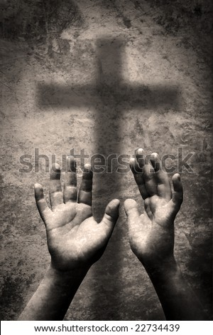 Hands and cross - stock photo