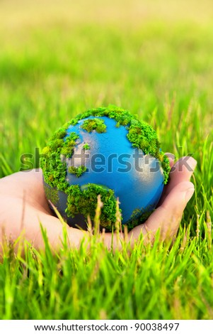 Hands and Earth. Concept Save green planet. - stock photo
