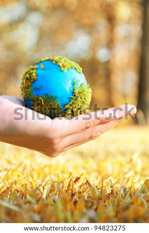 Hands and Earth, earth warming concept - stock photo