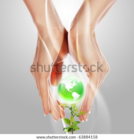 Hands and Earth. Symbol of environmental protection - stock photo