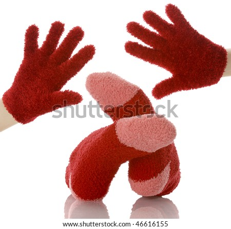 hands and feet with matching socks and mittens with reflection on white background - stock photo